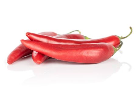 Group of four whole hot red chili cayenne isolated on white background
