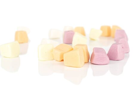 Lot of whole disordered soft pastel candy isolated on white background
