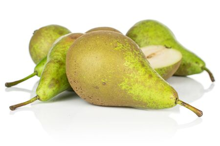 Lot of whole one half of fresh green pear isolated on white background