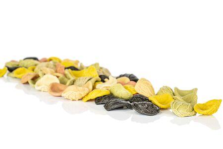 Lot of whole colorful pasta orecchiette in diagonal isolated on white background Banco de Imagens