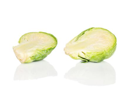 Group of two halves of fresh green brussels sprout isolated on white background