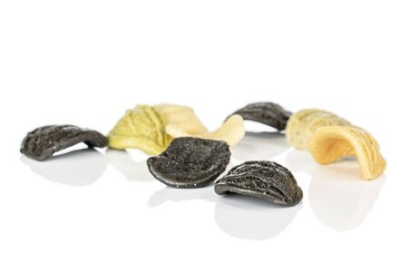 Group of eight whole colorful pasta orecchiette isolated on white background