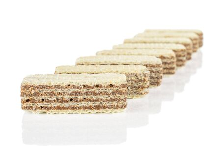 Lot of whole crispy beige hazelnut wafer cookie isolated on white background