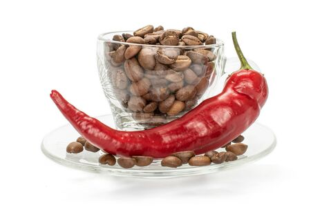 One whole fresh hot pepper with full cup of coffee beans isolated on white background