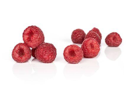 Group of nine whole fresh red raspberry isolated on white background