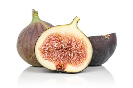 Group of one whole two halves of sweet purple fig isolated on white background
