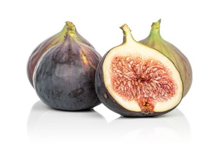 Group of three whole one half of sweet purple fig isolated on white background