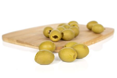 Lot of whole marinated green olive on bamboo cutting board isolated on white background Stok Fotoğraf