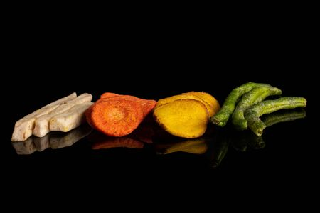 Lot of whole dry vegetable chip isolated on black glass Stok Fotoğraf