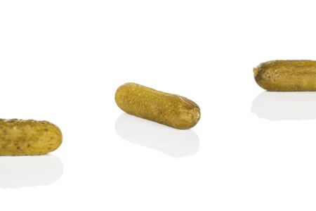 Group of three whole sour green pickle isolated on white background