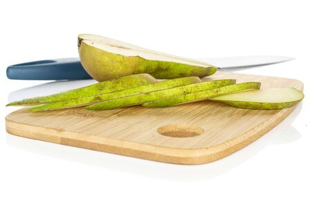 Group of one half five slices of fresh green pear on bamboo cutting board with steel knife isolated on white background 写真素材
