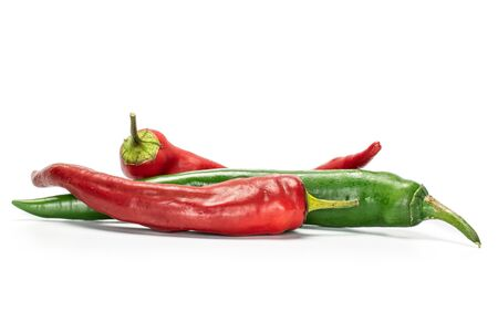 Group of three whole fresh hot pepper isolated on white background