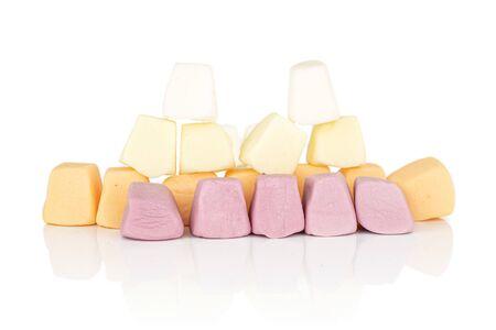 Lot of whole arranged soft pastel candy isolated on white background