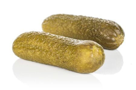 Group of two whole sour green pickle isolated on white background