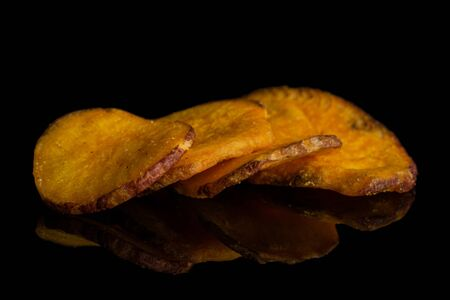 Group of four whole dry vegetable chip of gourd isolated on black glass 写真素材