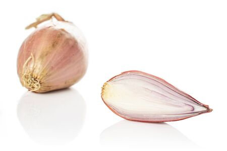 Group of one whole one half of fresh brown shallot isolated on white background