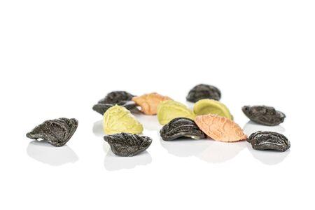 Lot of whole colorful pasta orecchiette isolated on white background Banco de Imagens