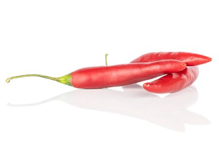 Group of three whole hot red chili cayenne heap isolated on white background Stock Photo