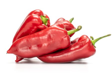 Group of four whole bright sweet red bell pepper isolated on white background