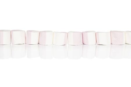 Group of ten whole sweet pastel marshmallow isolated on white background
