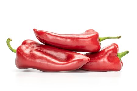 Group of three whole sweet red bell pepper isolated on white background Zdjęcie Seryjne