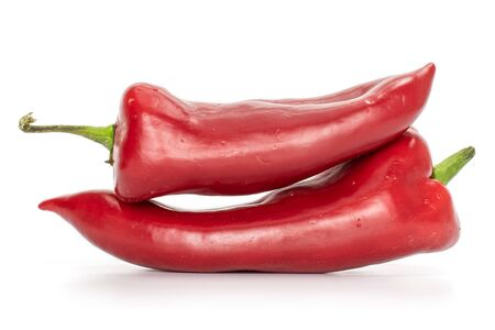Group of two whole ripe sweet red bell pepper isolated on white background