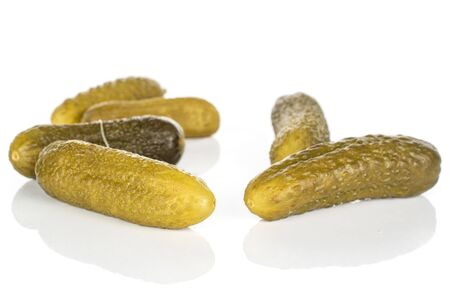 Group of six whole sour green pickle isolated on white background