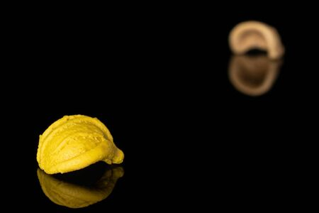 Group of two whole colorful pasta orecchiette isolated on black glass 版權商用圖片