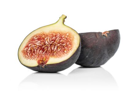 Group of two halves of sweet purple fig isolated on white background