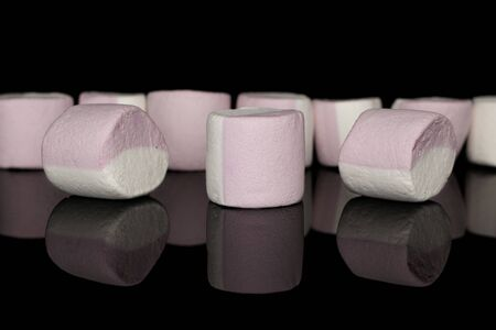 Lot of whole sweet pastel marshmallow isolated on black glass 스톡 콘텐츠