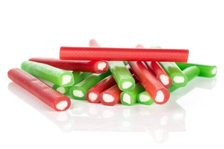 Lot of whole sweet stick candy heap isolated on white background