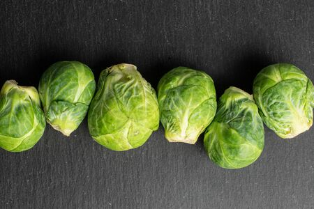 Group of six whole fresh green brussels sprout flatlay on grey stone 版權商用圖片