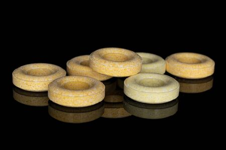 Group of seven whole round pale yellow candy isolated on black glass 版權商用圖片