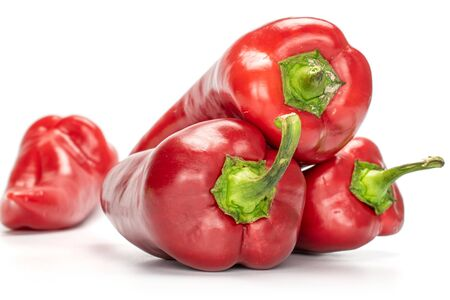 Group of four whole sweet red bell pepper isolated on white background Zdjęcie Seryjne