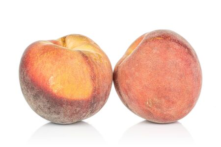 Group of two whole sweet red peach isolated on white background