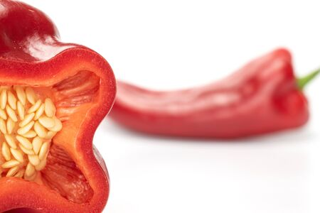 Group of one whole one half of sweet red bell pepper isolated on white background Reklamní fotografie