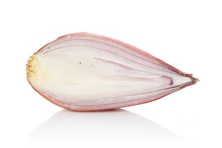 One half of fresh brown shallot isolated on white background