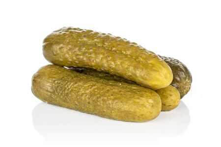 Group of four whole sour green pickle isolated on white background