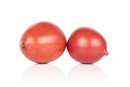 Group of two whole fresh tomato de barao isolated on white background