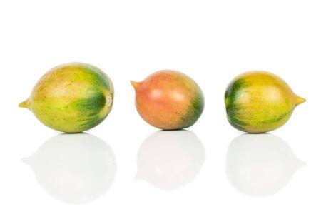 Group of three whole fresh tomato de barao isolated on white background