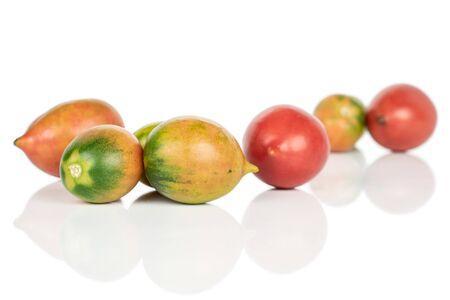 Group of seven whole fresh tomato de barao isolated on white background