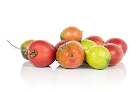 Lot of whole fresh tomato de barao heap isolated on white background Banco de Imagens