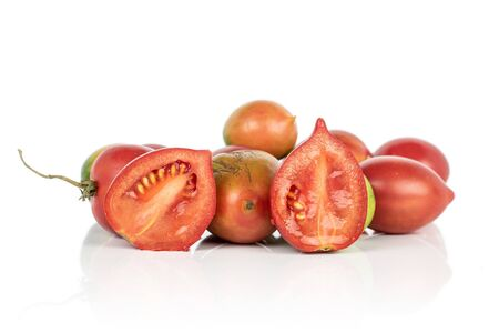 Group of lot of whole two halves of fresh tomato de barao isolated on white background