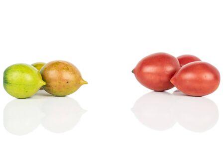 Group of six whole fresh tomato de barao isolated on white background