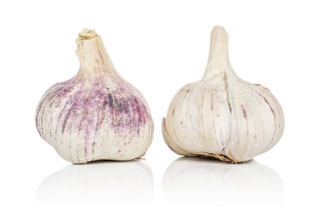 Group of two whole aromatic white garlic isolated on white background