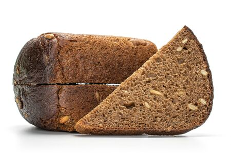 Group of two halves one slice of fresh baked dark bread isolated on white background