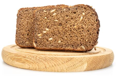 Group of two slices of fresh baked dark bread on bamboo plate isolated on white background