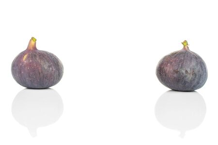 Group of two whole fresh purple fig placed aside isolated on white background Imagens