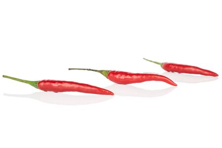 Group of three whole hot red chili isolated on white background