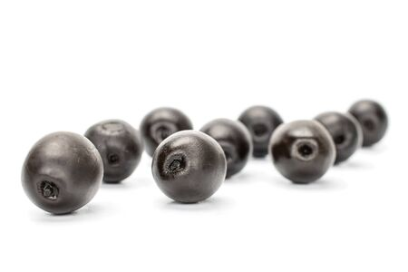 Lot of whole canned black olive isolated on white background Imagens